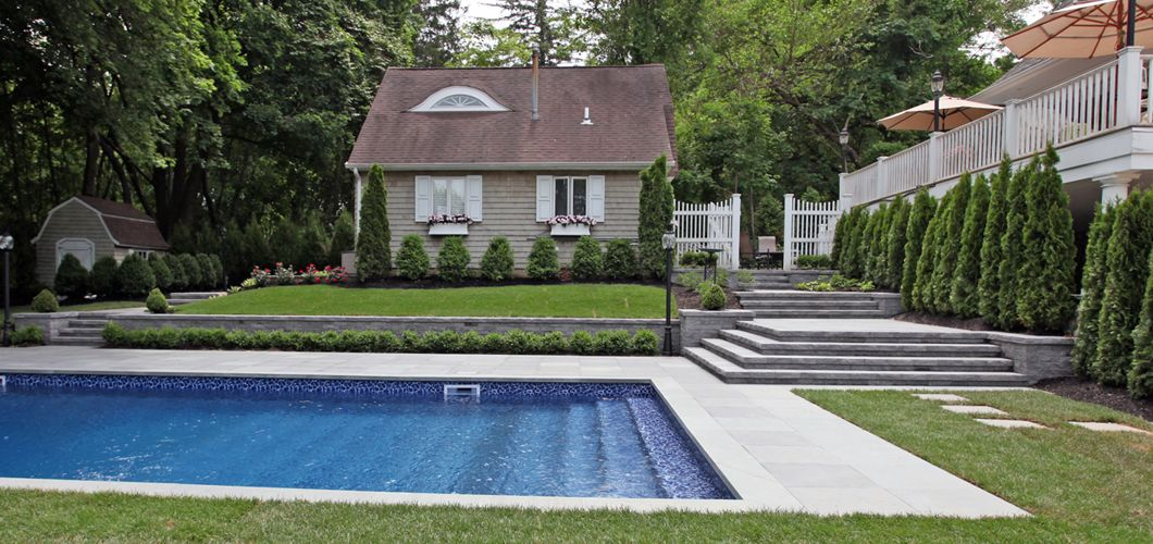 Rectangular Pool Landscape Designs hampton-style rectangular pool design built using @cambridgepavers