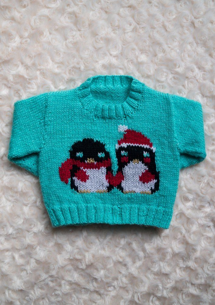 30cebf2fb051 This adorable penguin sweater is knitted and uses intarsia for the cute  design. The ice-blue is the perfect winter shade!
