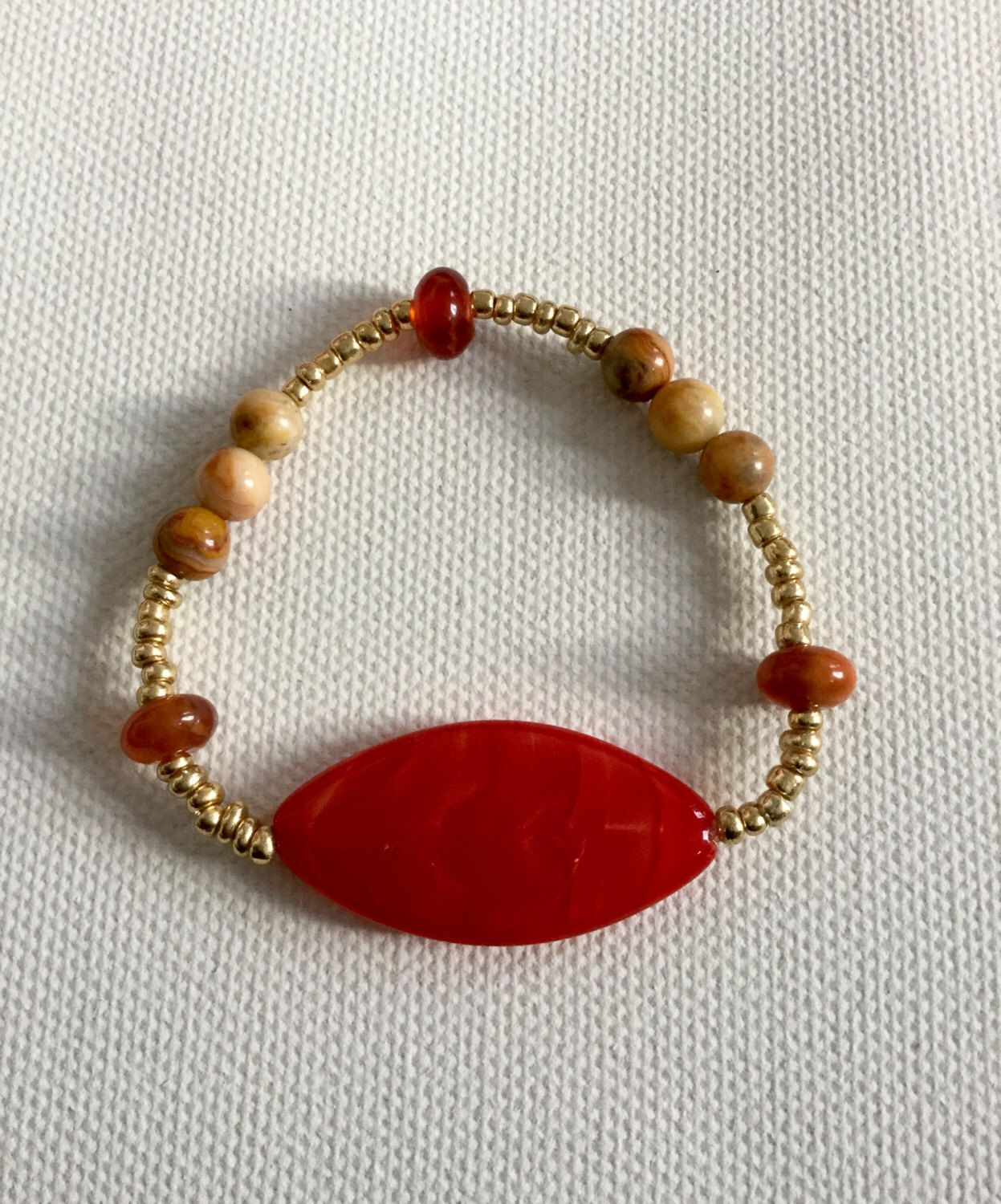 A personal favourite from my Etsy shop https://www.etsy.com/uk/listing/288772535/coral-and-gold-summer-stackable-bracelet