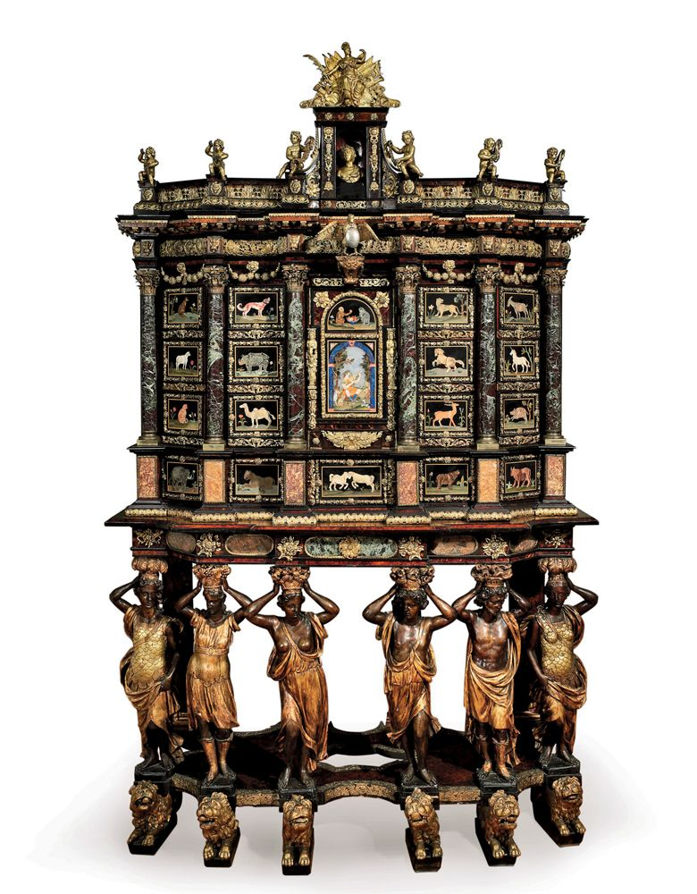 Cabinet-on-stand attributed to Domenico Cucci (1635-1704)  and the Gobelins workshop, c. 1665-1675. Carved, ebonized, and parcel-gilded ash with pietra dura and tortoiseshell panels and gilt-bronze mounts; height 97½, width 60½, depth 26 (cabinet) and 30½ (stand) inches.