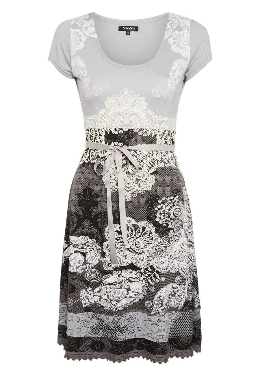 Add flair to your dress collection with this printed dress by Stella Morgan. With an intricate all over print, the dress comes with a delicate embroidered hem, scoop neck, short sleeves and a ribbon tie at the waist. </li><li>Slips on over the head</li><li>Sits above  the knee. Model height is 5 feet 10 inches</li>