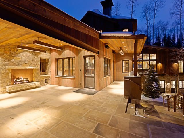 Merveilleux Outdoor Fireplace Set In Stone Wall; Built In Patio Heaters; Large Rock  Patio Surface