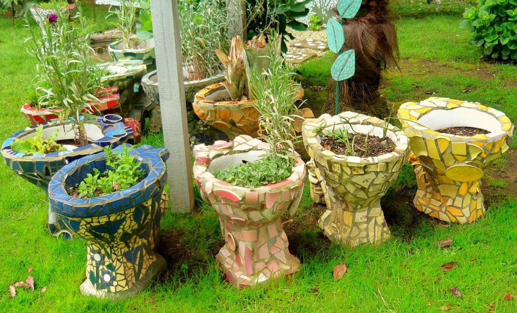 What To Do With Too Many Old Dunnies Toilets Mosaic Garden Art Mosaic Garden Garden Whimsy