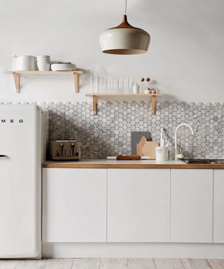 Stylish Kitchen | tile wall, wood countertop, retro white fridge, lamp shade
