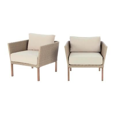 Enhance the style of your outdoor entertainment setting with this 2-piece patio seating set. It is crafted with wood-looking material, adding a fashionable yet functional touch to your space. The set includes two armchairs with cozy, fade-resistant cushions that are 5 in. deep for added comfort. It features a durable, powder-coated steel frame and a hand-painted teak finish to prevent rusting. You can easily move these lightweight chairs around in your space, creating versatile design possibilit