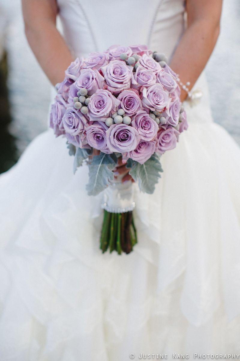 Purple rose bridal bouquet at modern black tie wedding the