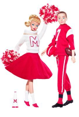"""Campus Spirit™Barbie® Doll and Ken® Doll Giftset The Barbie Collection.Gold Label® Release Date:6/1/2008 This vintage reproduction Barbie® doll wears a re-creation of 1964's """"Cheerleader"""" Barbie® Fashion #876, while Ken® doll is devastatingly handsome dressed in """"Touchdown"""" Ken® Fashion #799, originally released in 1963. Two favorite fashions — finally available to you again and housed in packaging featuring vintage art!"""