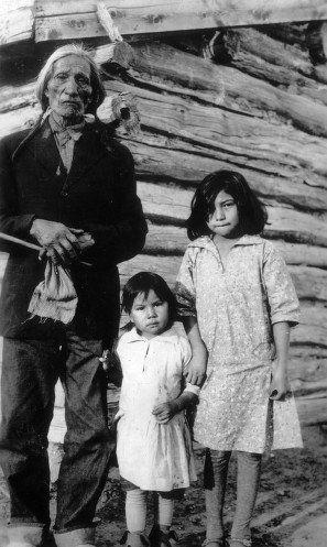 Sadness... / Oglala man with his grandchildren - circa 1940
