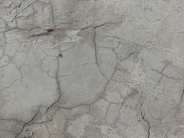 Concrete Texture In Light Grey Color With Few Thin Cracks Rough Surface