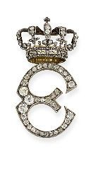 A LADY-IN-WAITING BADGE FOR QUEEN ELENA OF ITALY, BY MUSY. Designed as a diamond-set initial 'E' with crown above, mounted in silver and gold, circa 1900. Queen Elena of Italy née Elena del Montenegro married Victor Emmanuel III of Italy in 1896 .