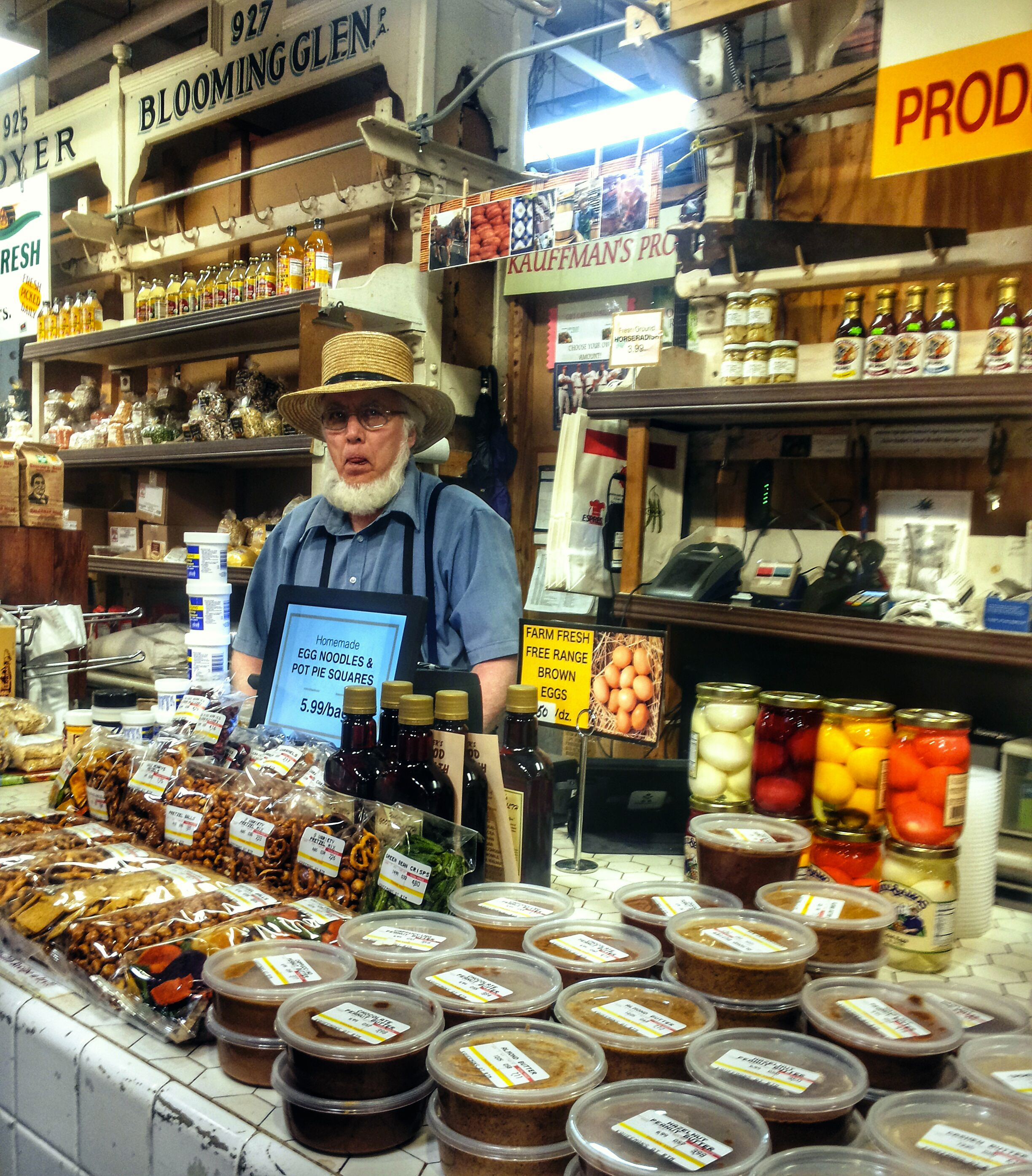 Amish farmer at Reading Terminal Market in Philadelphia. His peanut butter was great!