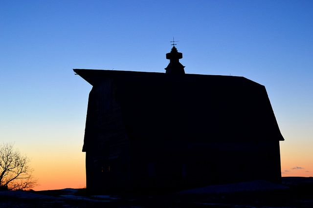 As evening arrives...  An aging barn on an unoccupied farmstead in rural Pierce County, ND in silhouette before an early evening sky.