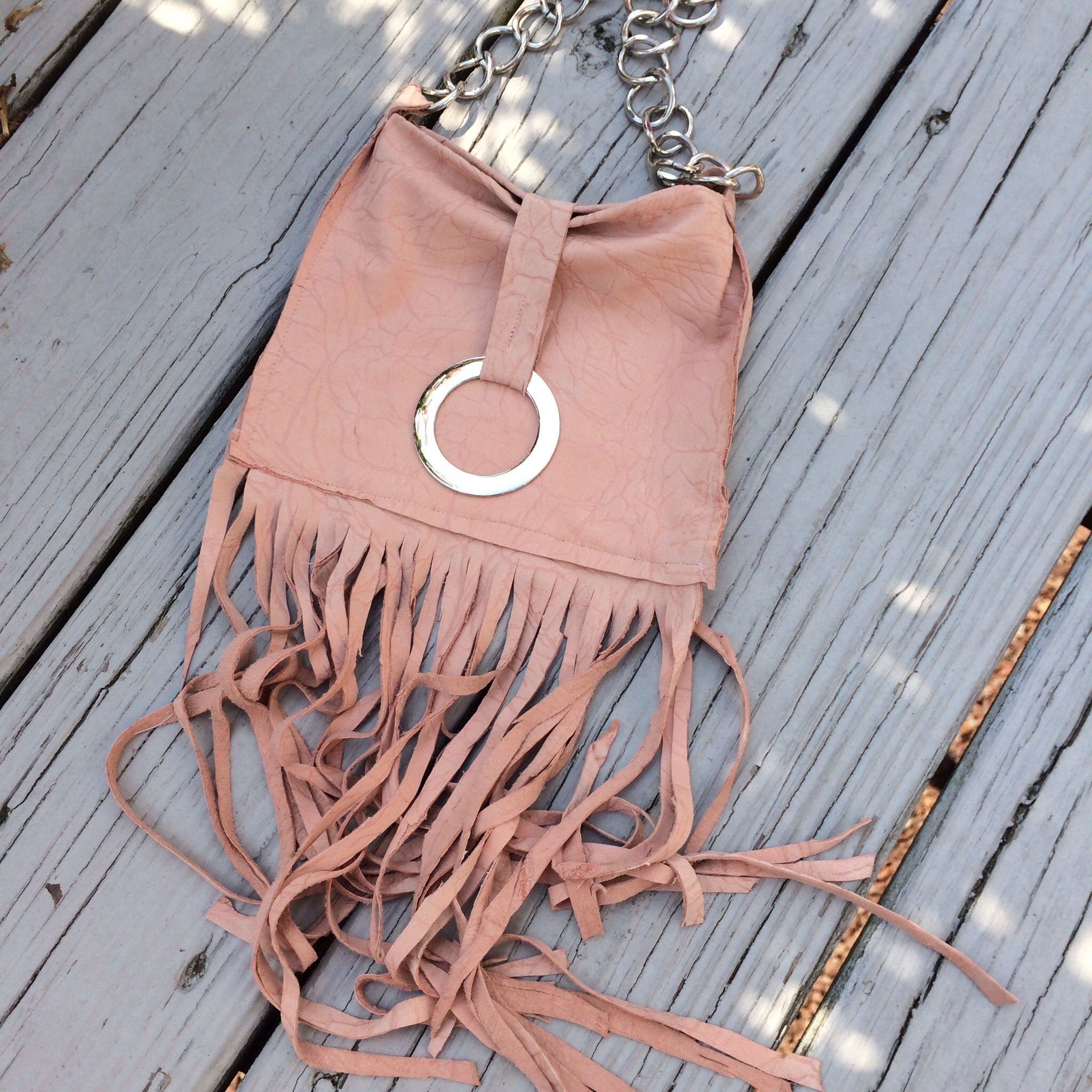 Pink leather fringe hand bag. Is in my closet!