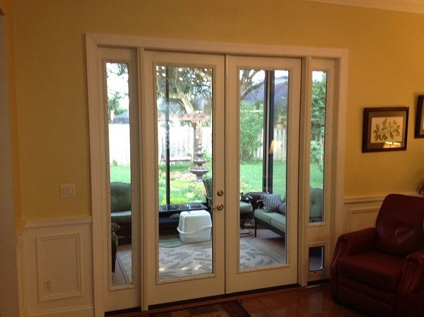 French Door With Sidelites And Pet Door This Was A Sliding Glass