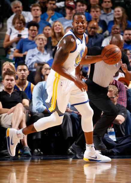 Andre Iguodala of the Golden State Warriors handles the ball against the Dallas Mavericks during a preseason game on October 23 2017 at the American...