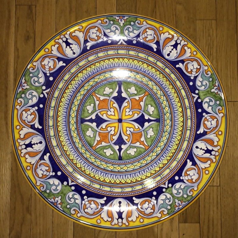 Hand thrown on the potters wheel, and an exceptionally fine example of old-world Italian ceramic art, this large decorative piece looks destined to become a valuable museum piece! But first it is just the thing to enhance your entryway, great room, dining room or living room! A handmade and hand painted Italian pottery