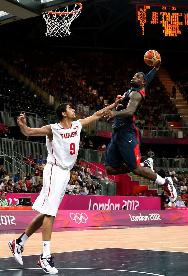 c11687fc060c LeBron James dunks over Mohamed Hadidane during Tuesday s game between the  United States and Tunisia. Team USA led by just 13 points at halftime  before ...