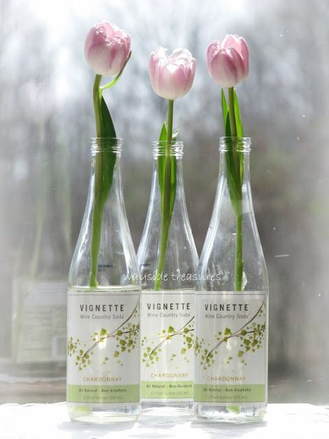 tulips in wine bottles