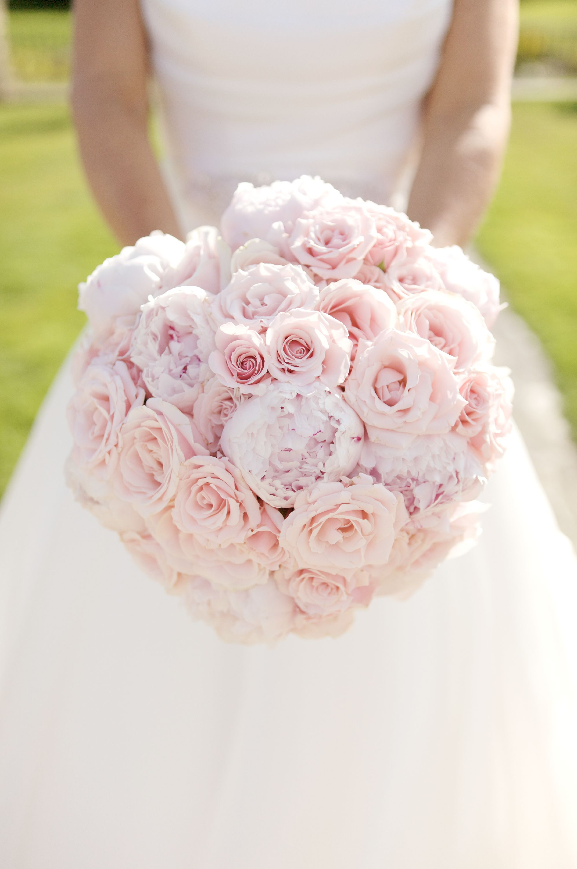 A unique domed hand tied bouquet of light pink sweet ...