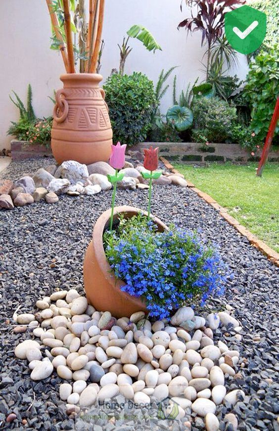 30 Wonderful DIY ideas with stone flower beds Front yard