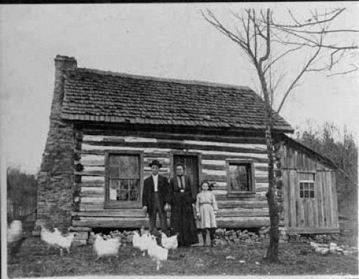 Family in Front of Their Log Cabin