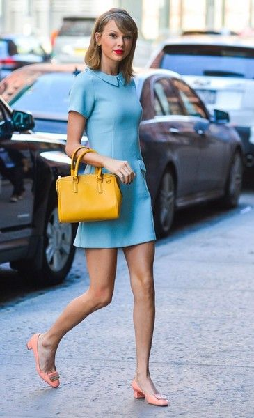 Taylor Swift Pumps - Taylor Swift kept the  60s vibe going with a pair of  chunky-heeled peach pumps by Jimmy Choo. 9769c863fb2