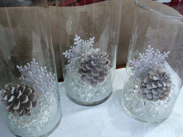 fill apothecary jars with crystal stones, pine cones, and snowflakes for winter decorating - by dining delight #winterdecor