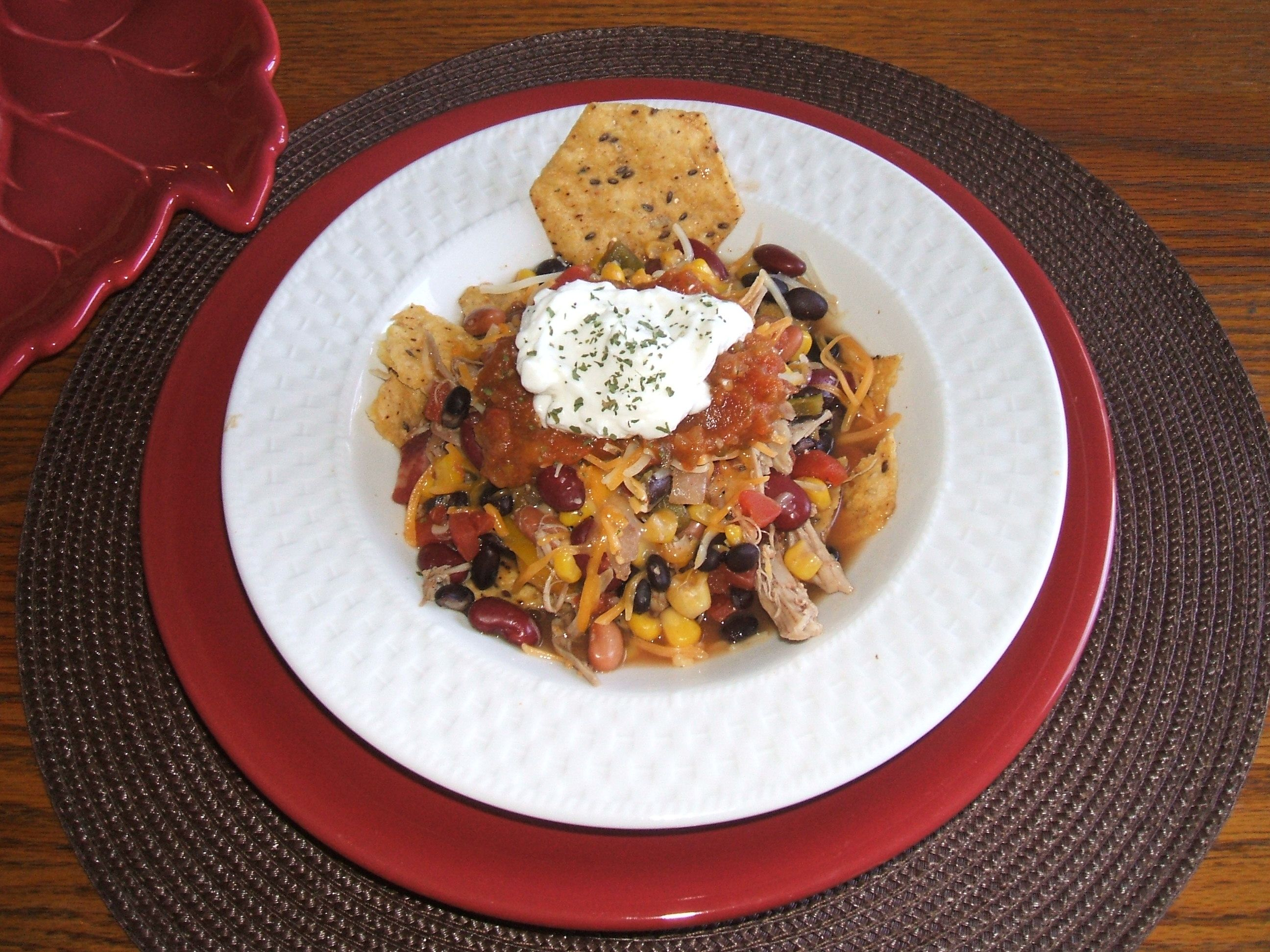 Crockpot Turkey Chili... I made this with leftover turkey from Allrecipes.com and added corn, onion and peppers.  Served over chips and topped w/ cheese, pumpkin salsa, light sour cream and cilantro.  Best chili ever!!!  And it looks great too.
