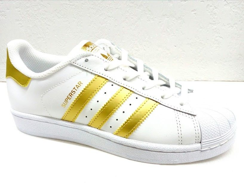 adidas superstar con righe oro