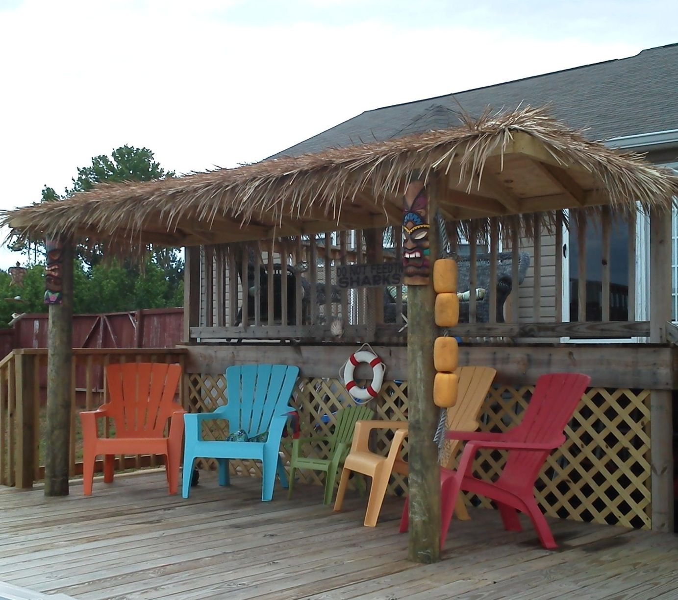 Our tiki hut decorated. The sign in back says Don't Feed ...