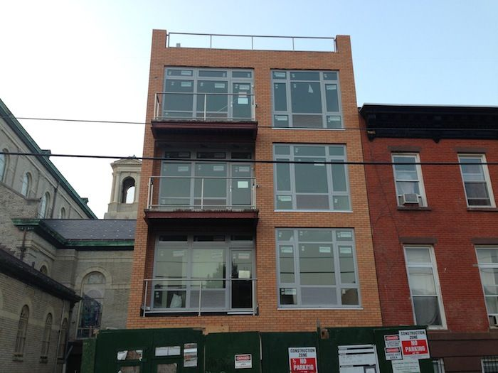 Windows in at two small buildings on dean street in for Small apartment building design