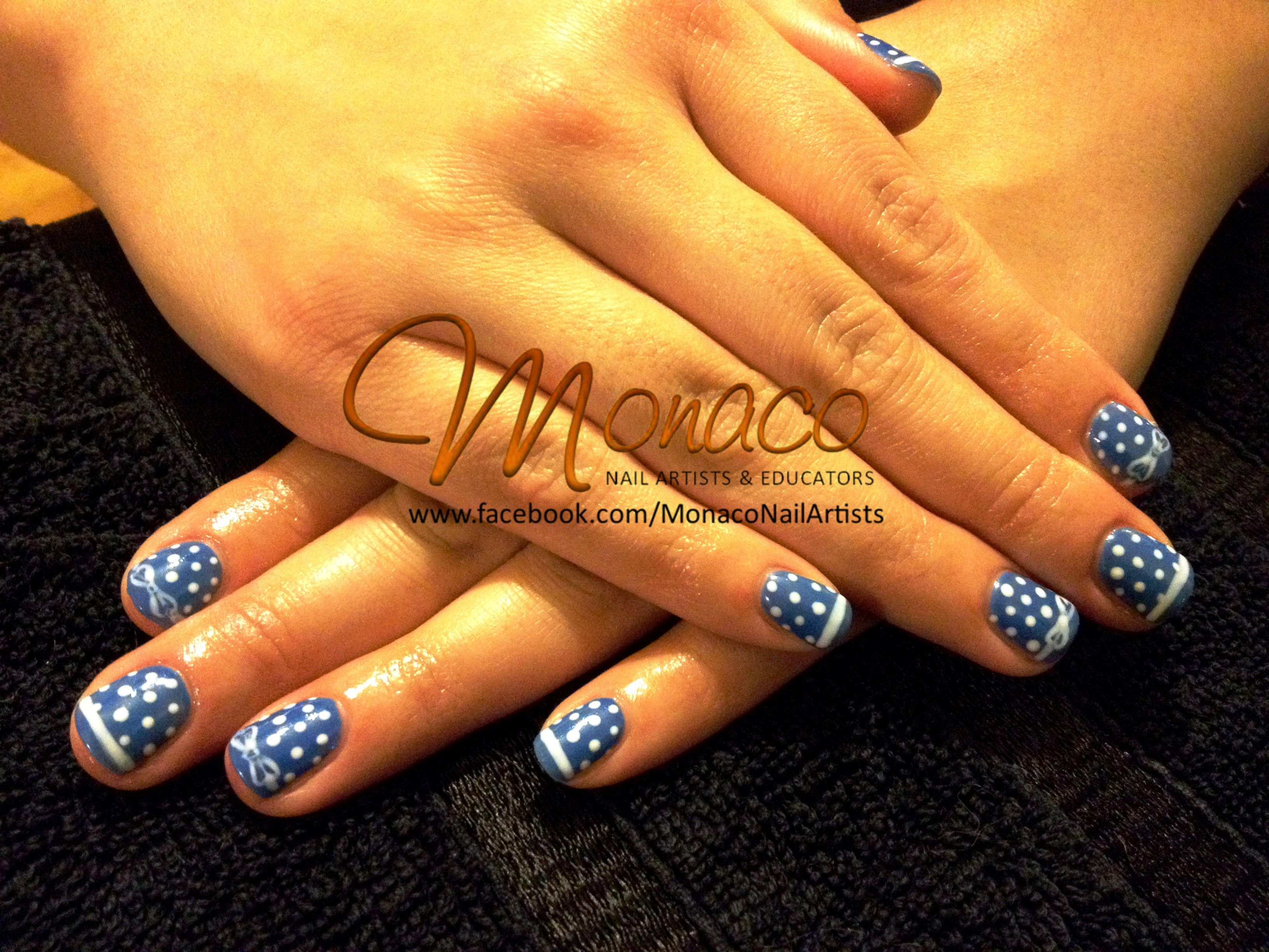 Bright Blue Nails with white PolkaDots and Bows from