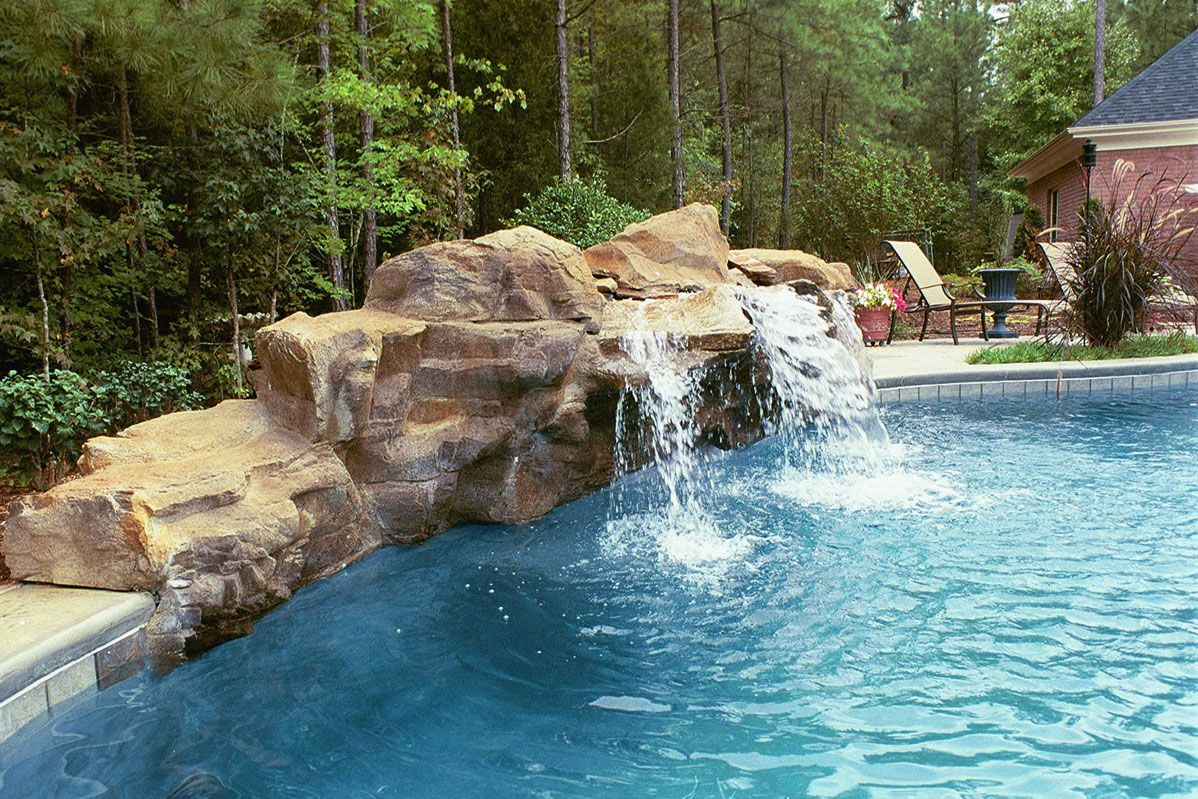 Swimming Pool Waterfall Designs heres a spectacular backyard pool complex thats akin to a private water park with a pool Beautiful Waterfalls Backyard Pool Design