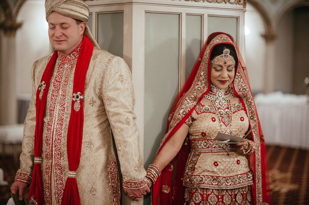 asian wedding photography east midlands%0A hindu christian indian wedding   bride wearing cream and red lengha   groom  in cream and