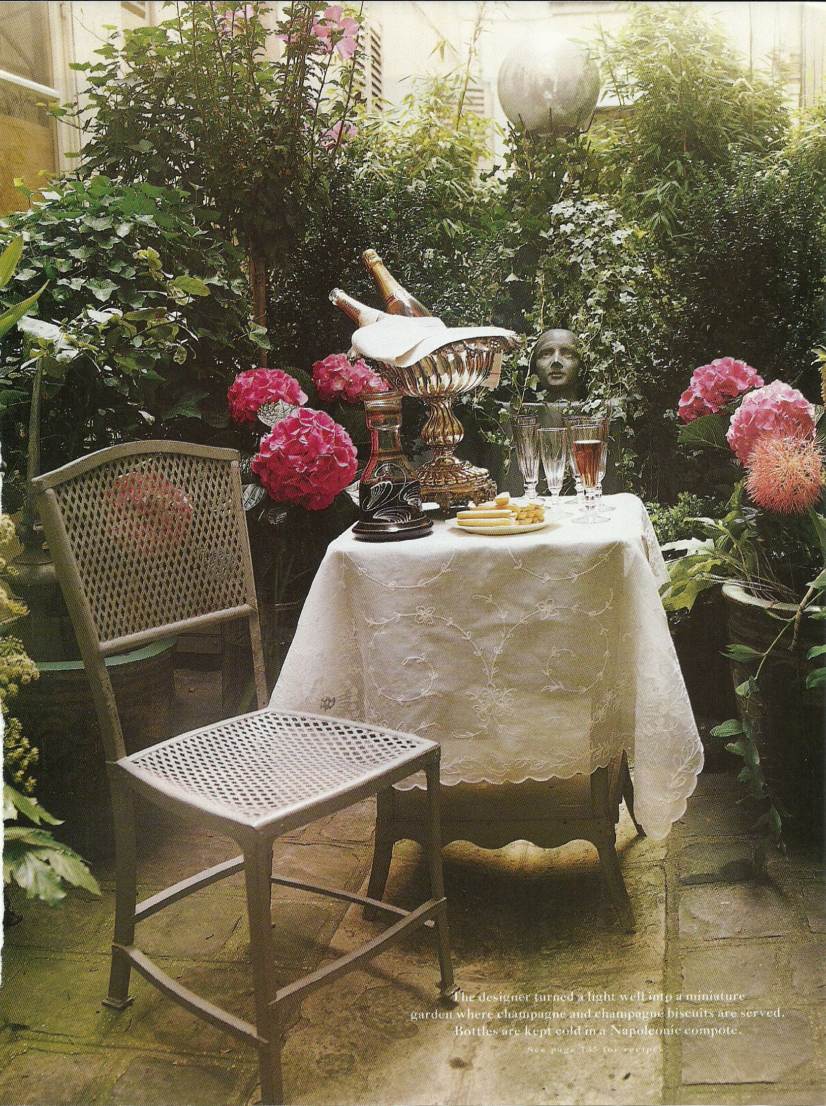 French chair, pink Hydrangeas, silver champagne bucket, gazing ball ...