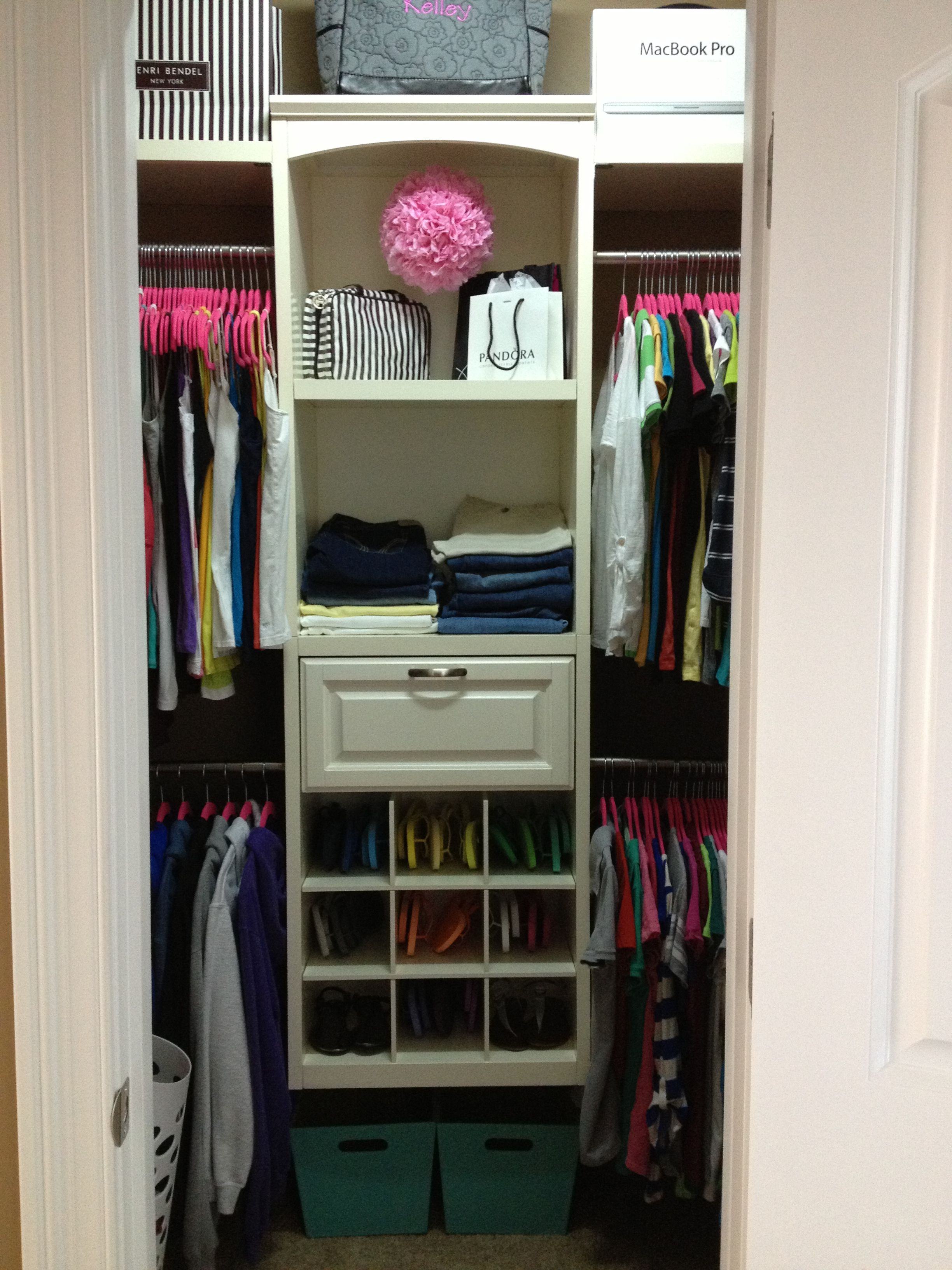 Small walk in closet organization girly closet for Organized walk in closet