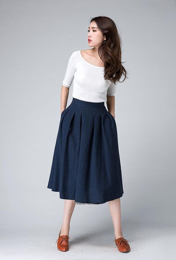 2aee3b7599 This high waisted midi skirt is Crafted with soft linen in a navy blue  hues, The fitted waist and pleated detail make this skirt feminine and  Chic,A lovely ...