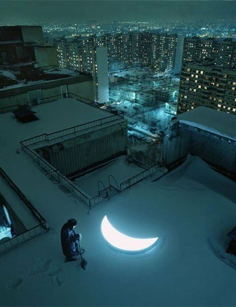 Moon shining on the rooftop