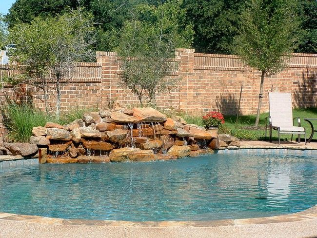 Pool Waterfall Ideas You Can Recreate in Your Backyard Pool