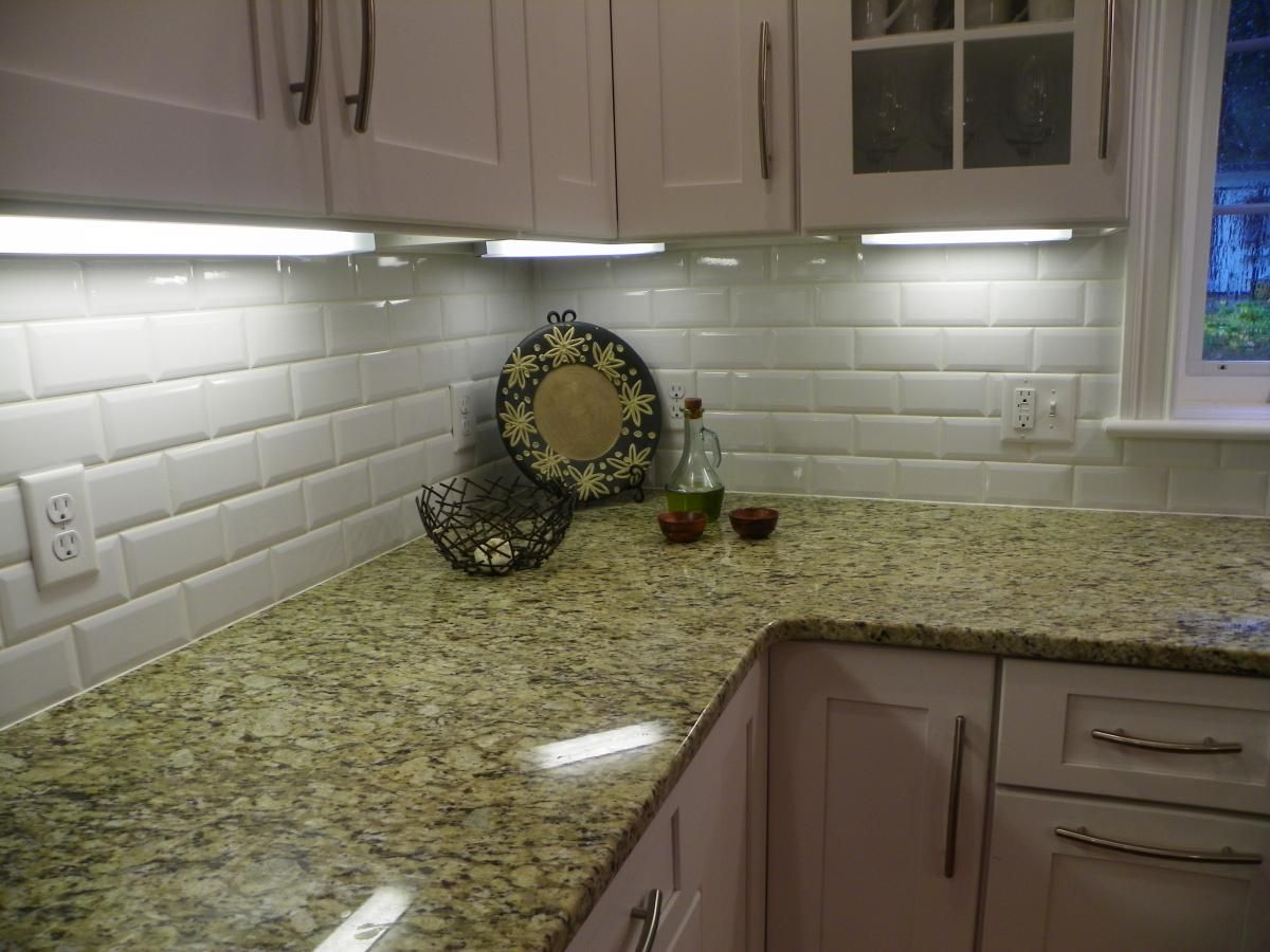 Picture Of Retro White Subway Tile Backsplash On Green Granite Countertop
