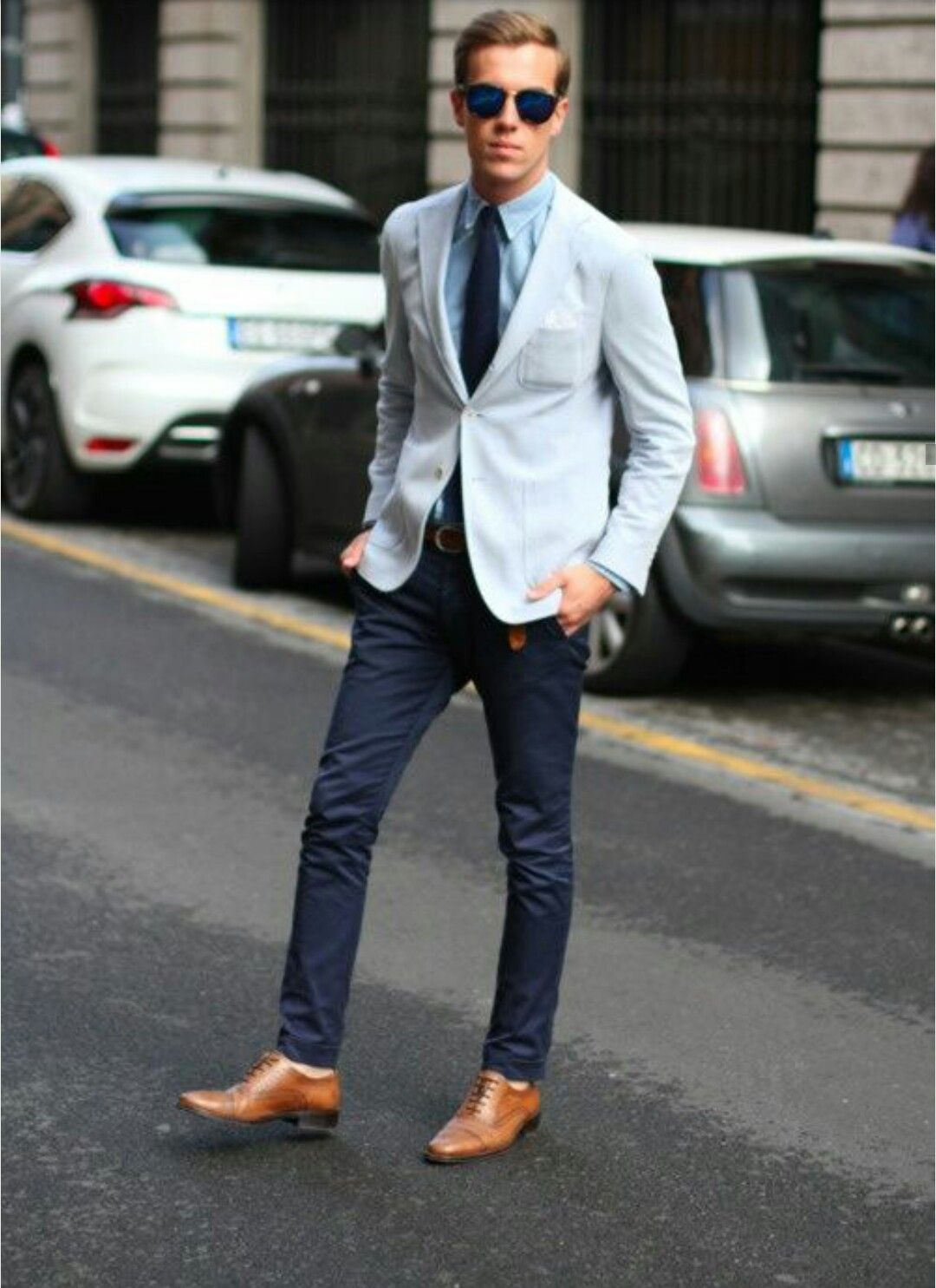 A smart casual combination of a baby blue sportcoat and dark blue chinos  can maintain its relevance in many different circumstances.