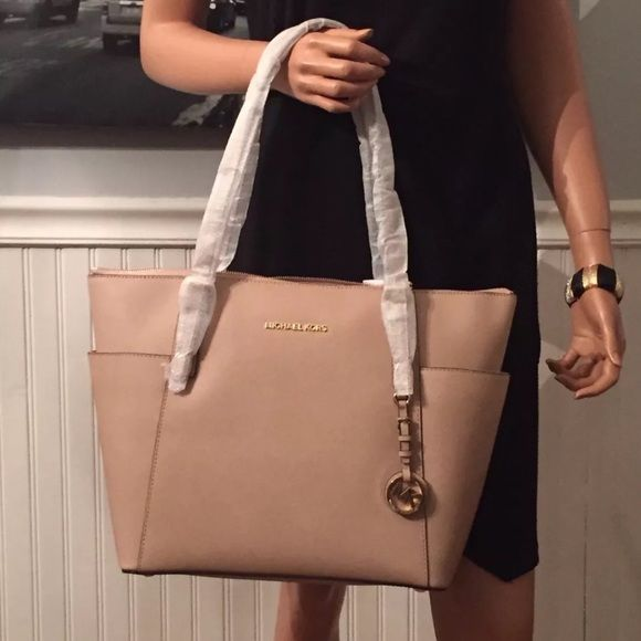"NEW Michael Kors Up for Sale is this Beautiful Michael Kors Large Jet Set East West in Blush color. •Saffiano leather; lining; polyester •Double handles with 7-1/2"" drop •Top Zip Closure •Exterior features 18k gold-plated hardware,signature lettering,hanging logo medallion and two side pockets •Interior features  •16""Wx11x-1/2""Hx5-1/2""D Michael Kors Bags Shoulder Bags"