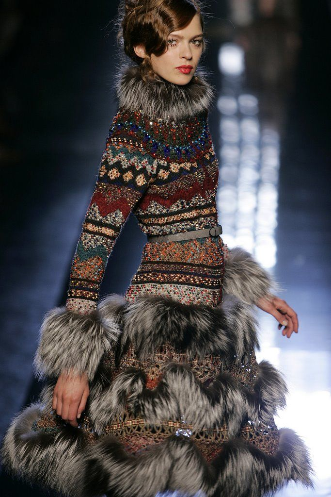 A knit and bead embroidered dress/coat by Jean-Paul Gaultier --- I like the sweater part of this... not such a huge fan of the fur.