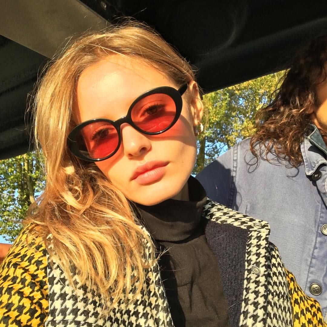 488d99bb334 Black sunglasses and plaid coat