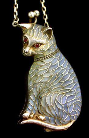 MEYLE & MAYER Cat Purse Pendant  Silver Plique-à-jour enamel Pendant: H: 7.8 cm (3.07 in)  W: 4.4 cm (1.73 in)  Chain: L: 74 cm (29.13 in)  Marks: '900' & indistinct maker's mark German, c.1900  The pendant opens to reveal a purse.