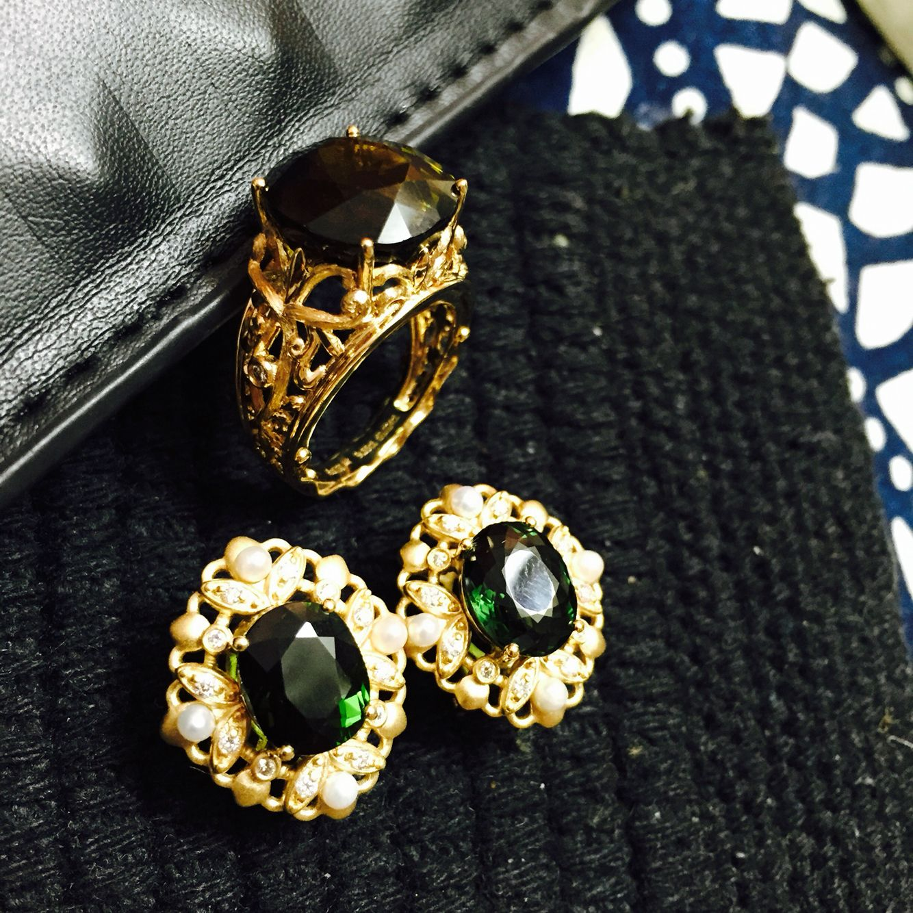 Handmade green tourmaline eatings and ring. They look gorgeous!
