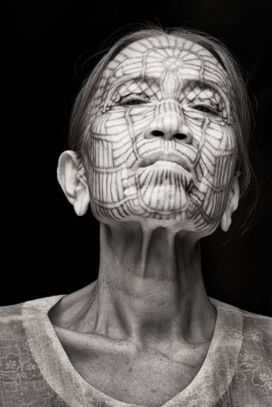 A Burmese woman with traditional facial tattooing, an ancient custom that is no longer practiced.