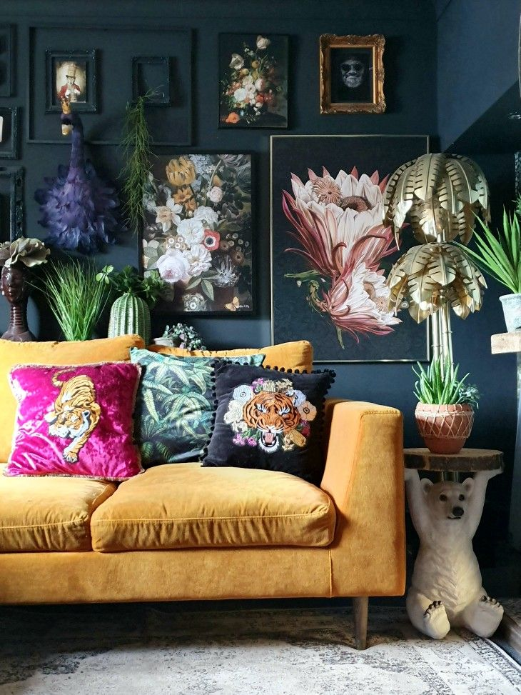 living room inspo with gallery wall and mustard sofa
