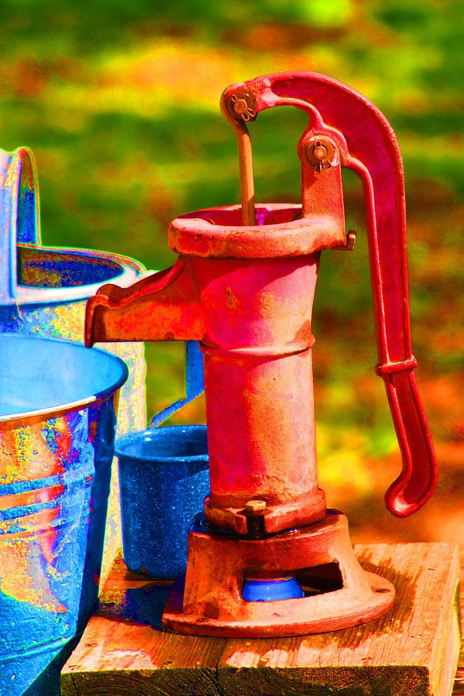 old water pump used as sink faucet