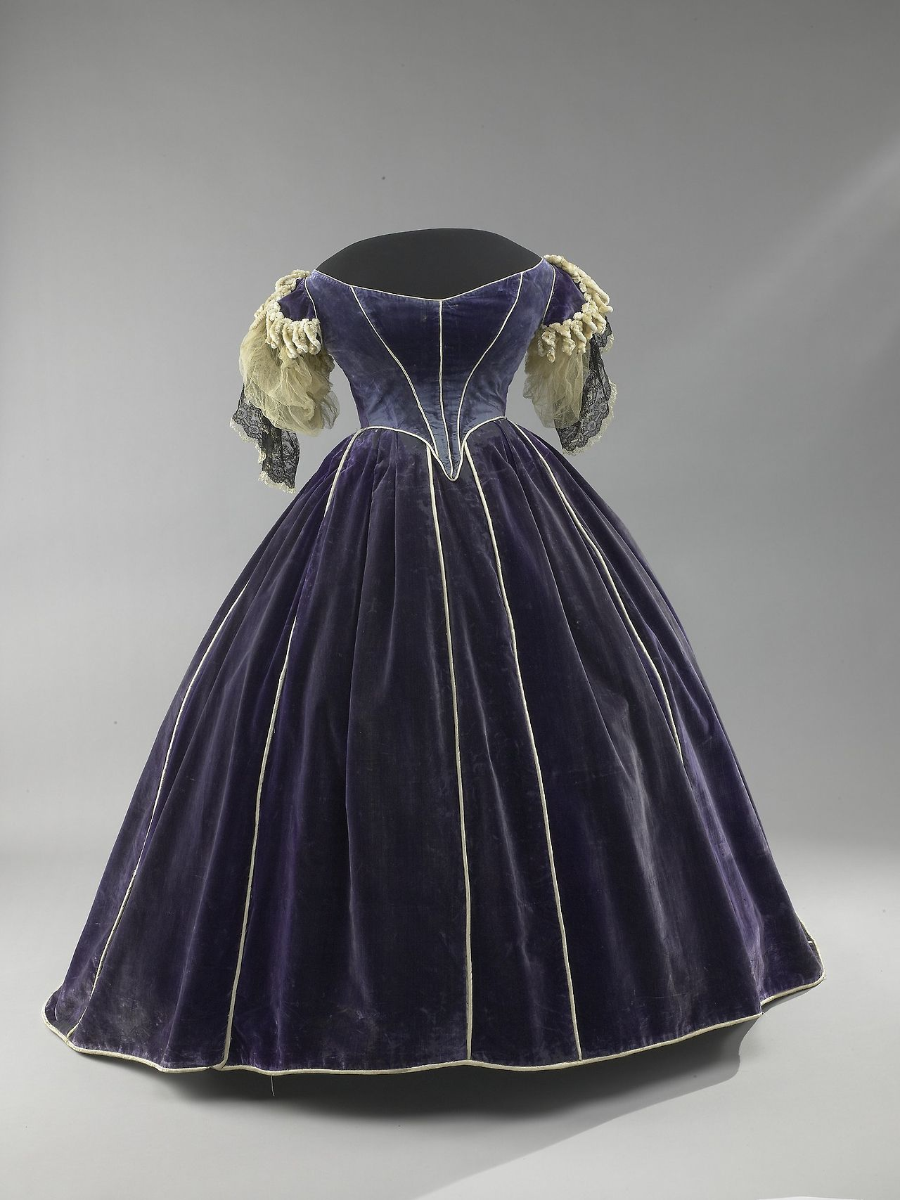 Purple velvet dress with piping trim with daytime and evening